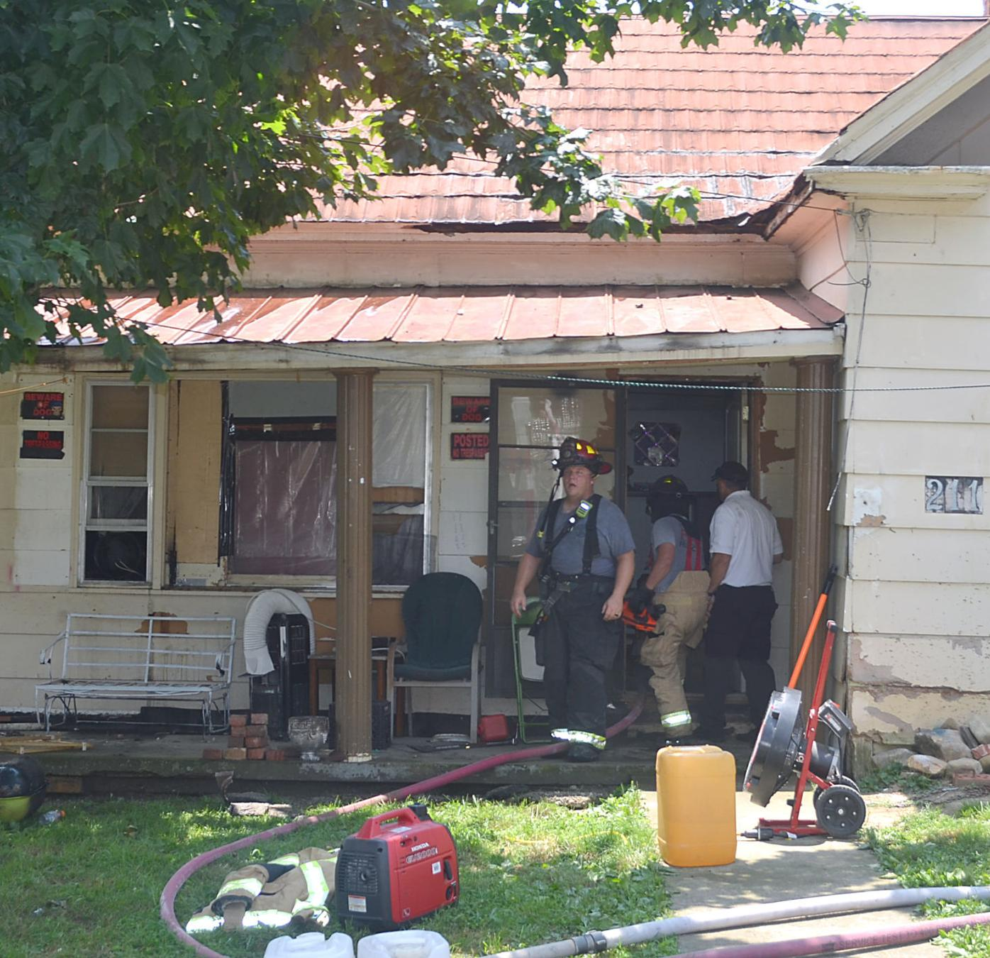 Firefighters Outside Front Door Of House