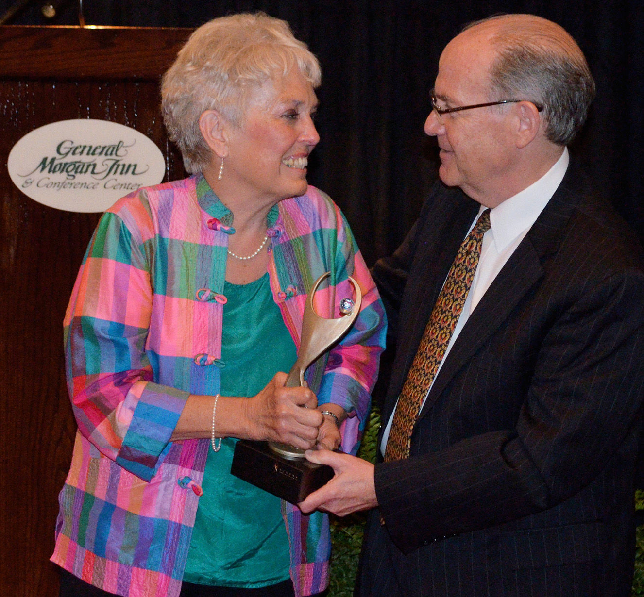 Joyce Johnson Accepts The Award From Greeneville Sun Co Publisher Gregg  Jones. The ATHENA Award Is Presented By The Sun And Sponsored By Roberts  Furniture.