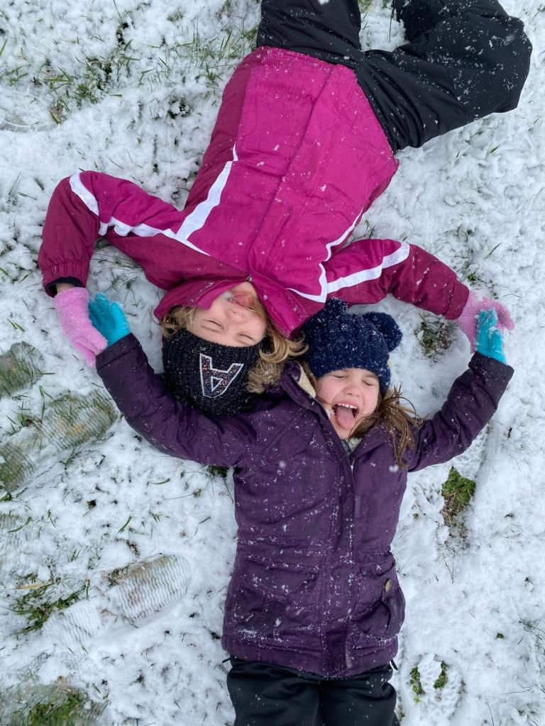 Addi and Kennedi Campbell Catching Snowflakes