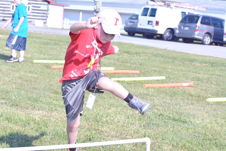 Cub Scout Clears Hurdle At Twilight Camp