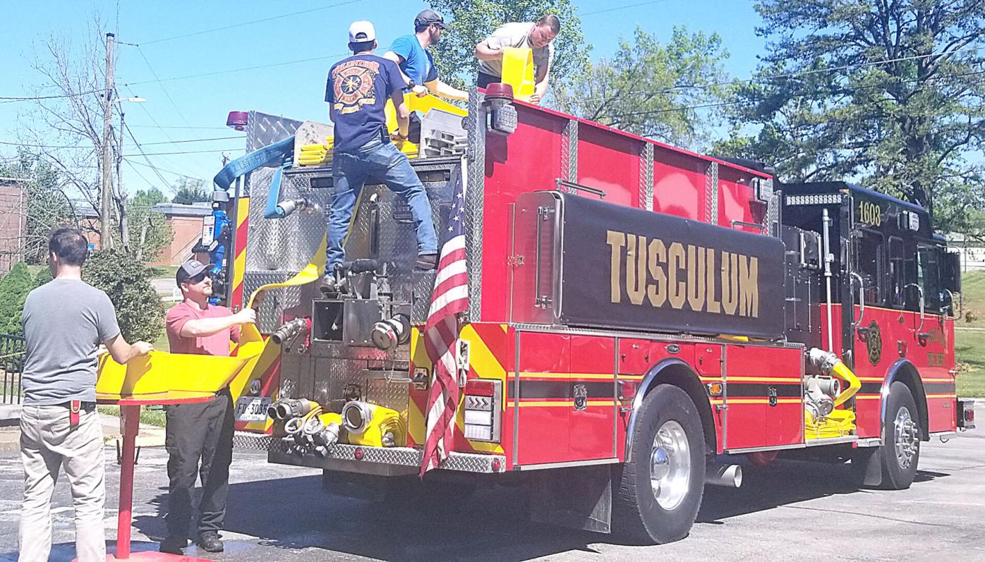 Firefighters Attach New Hoses To Truck