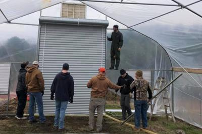 FVC-TN-Veterans-Helping-Veterans-install-hoophouse-from-NRCS-1.jpg