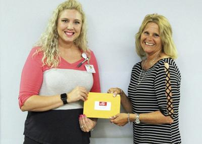 Aspen Place donates to Daily News Cheer Fund