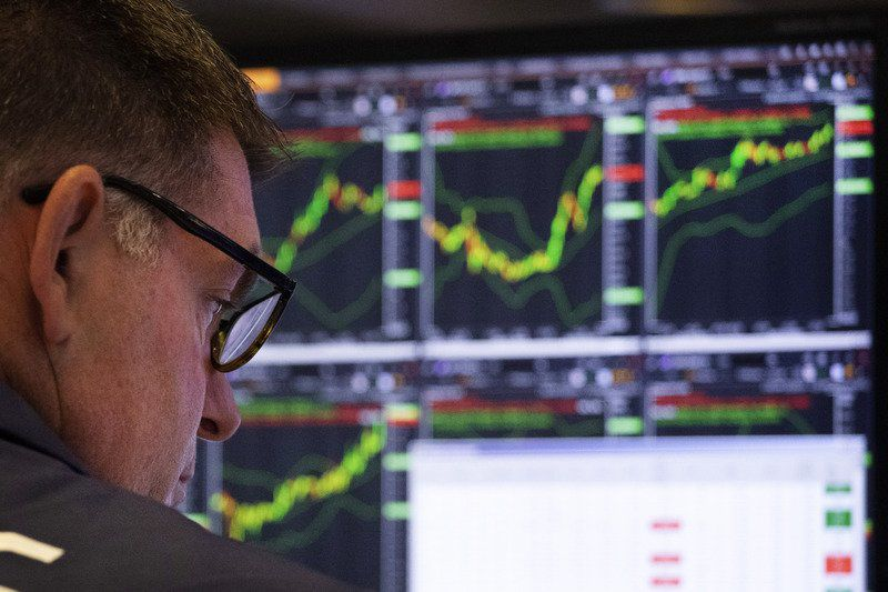 US stocks cap milestone-setting week with modest losses