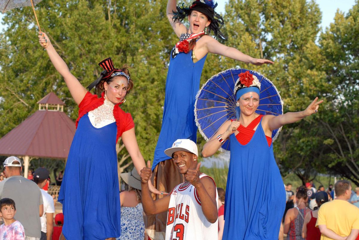 Mike Rivera and stilt walkers