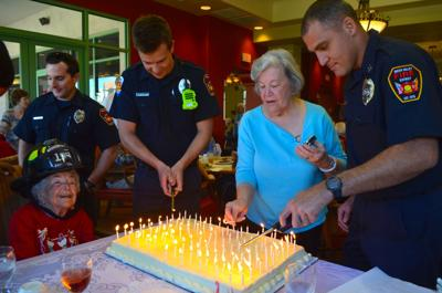 Irma Lundberg Seated Left Waits For Her 100 Birthday Candles To Be Lit By Green Valley Firefighter Sean Rickard Lundbergs Daughter Gail Williams