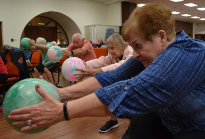 Helping balance Parkinson's: Caring instructor, students unite