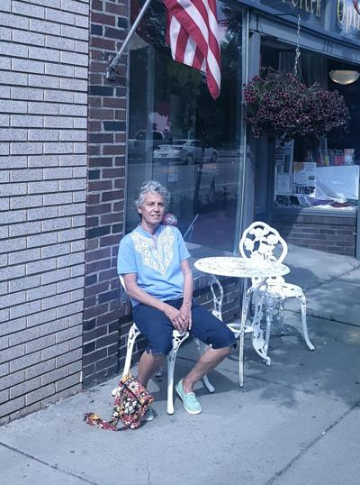 Dr. Flender sits for casual photo - Main Street, Dansville