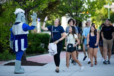 SUNY Geneseo Students being greeted by the SUNY Geneseo mascot Victor E. Knight!