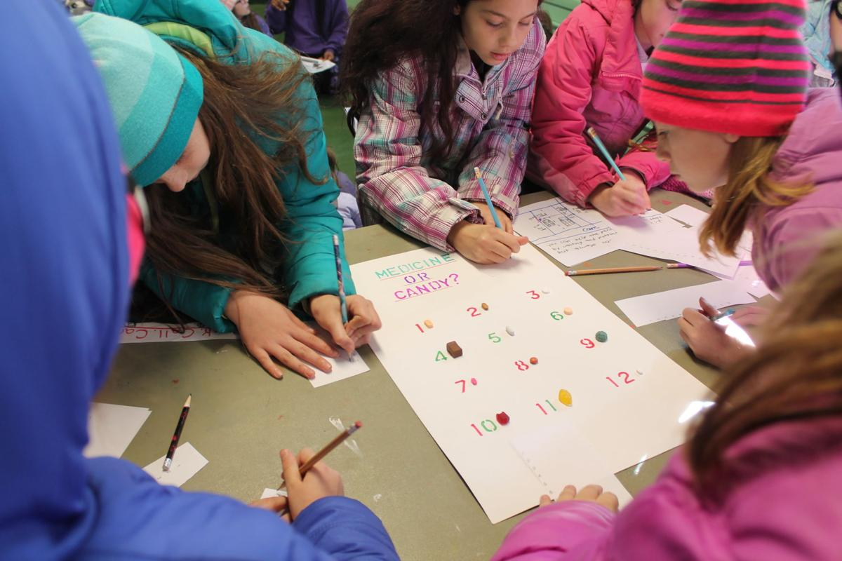 Girl Scouts attempt to guess what's candy and what's medicine.JPG