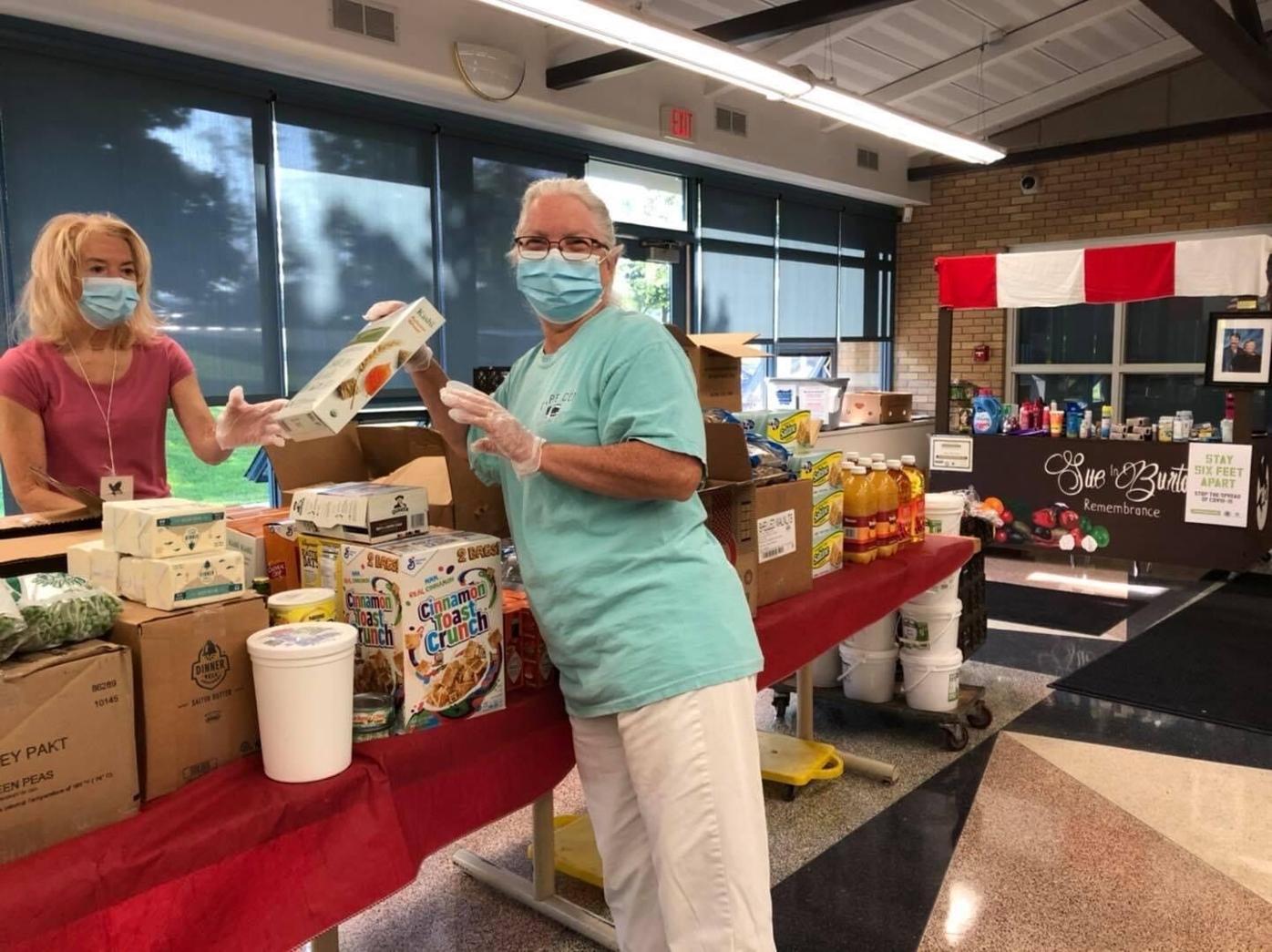 Sent by Ravens volunteers set up food pantry tables!