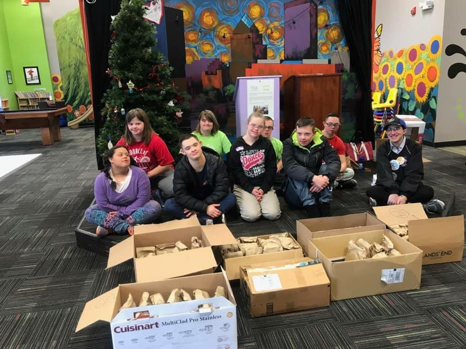 GiGi's Ambassadors with the Brown Bag Lunches They Made for the Open Door Mission
