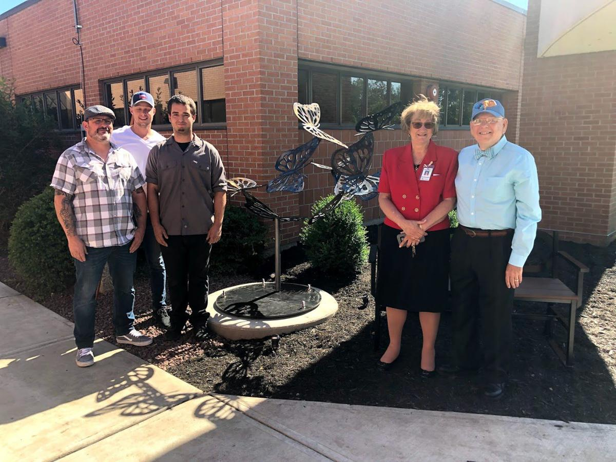 Fil Rocha, Kyle Tracey and Steven Rocha of Kyle's Metal Works, Noyes CEO Amy Pollard and David W. Smith