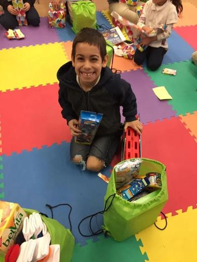 This young student is so excited for his Happy Birthday Cha Cha Cha presents!