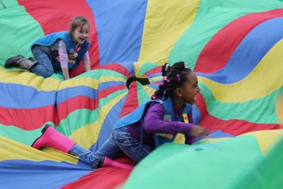 Daisy Girl Scouts enjoying a fun activity at a Daisy event.