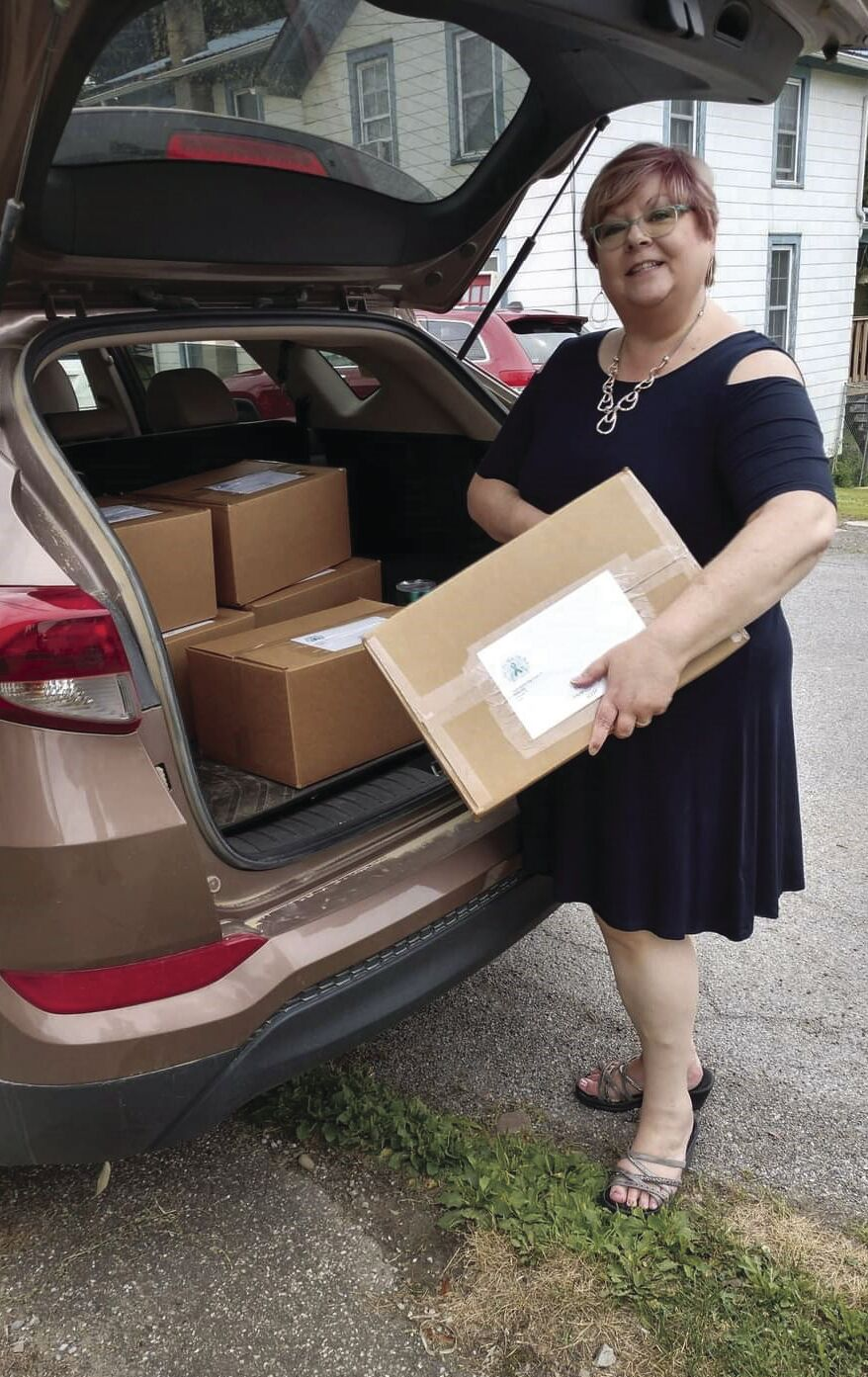 Jennifer Howe taking packages of comfort bags to the post office!