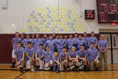 Byron-Bergen Team in front of the Donation Wall