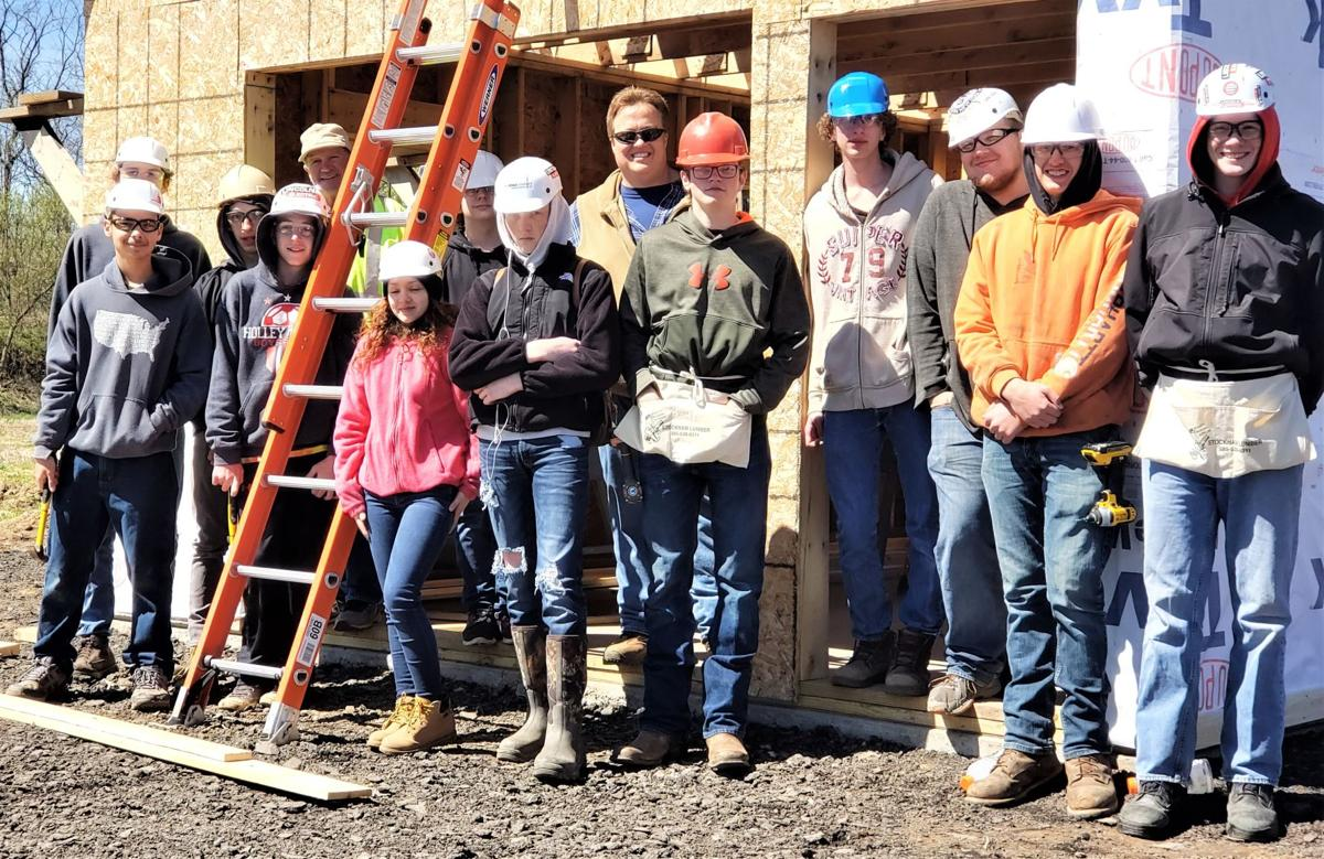 Albright, Rogers and Holley students installing a barn for Homesteads for Hope