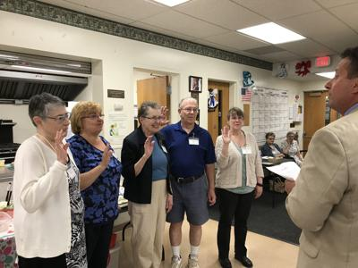Gates Town Supervisor Cosmo Guinta swears in Gates Historical Society new officers and board members