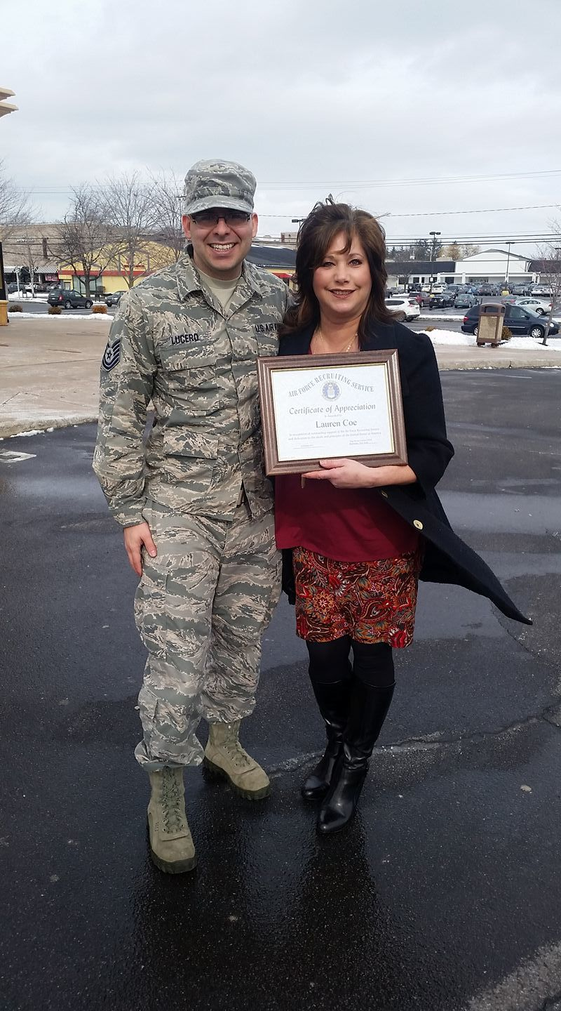 Lauren Coe presented with this plaque from the USAF for her work with OSAAT!