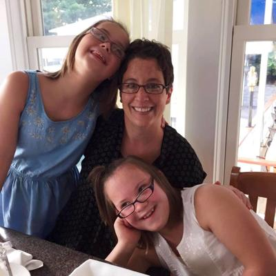 Arc of Genesee Orleans Board Member Deb Riggi and daughters Cassidy and Masha