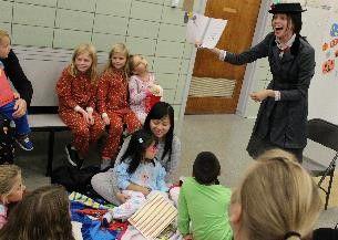 Guest reader Mary Poppins (kindergarten teacher Kerry Burnett) kept her audience spellbound..jpg