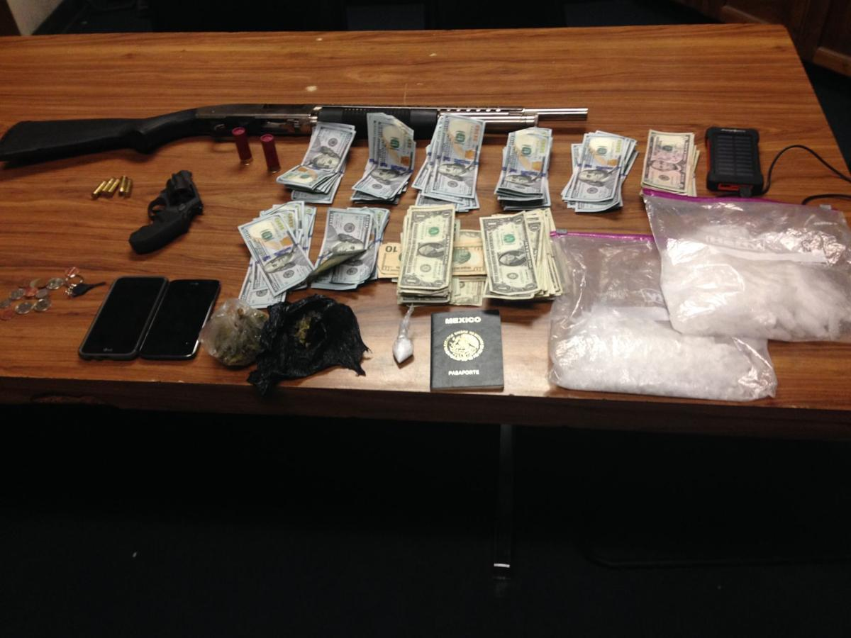 Guns, drugs, cash in Corcoran traffic stop