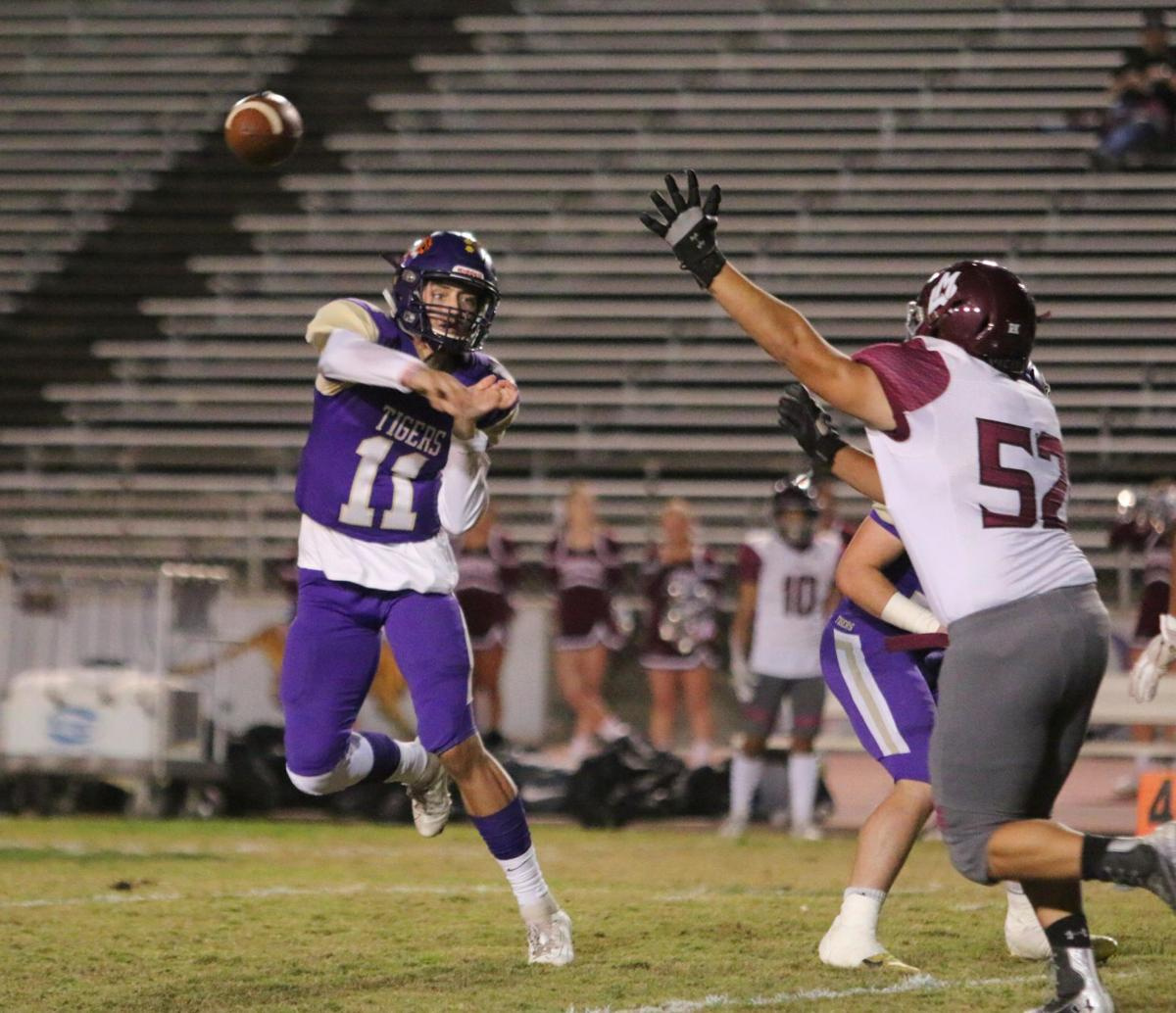 Tigers stay hot with 42-6 rout of Pioneers, clinch playoff spot