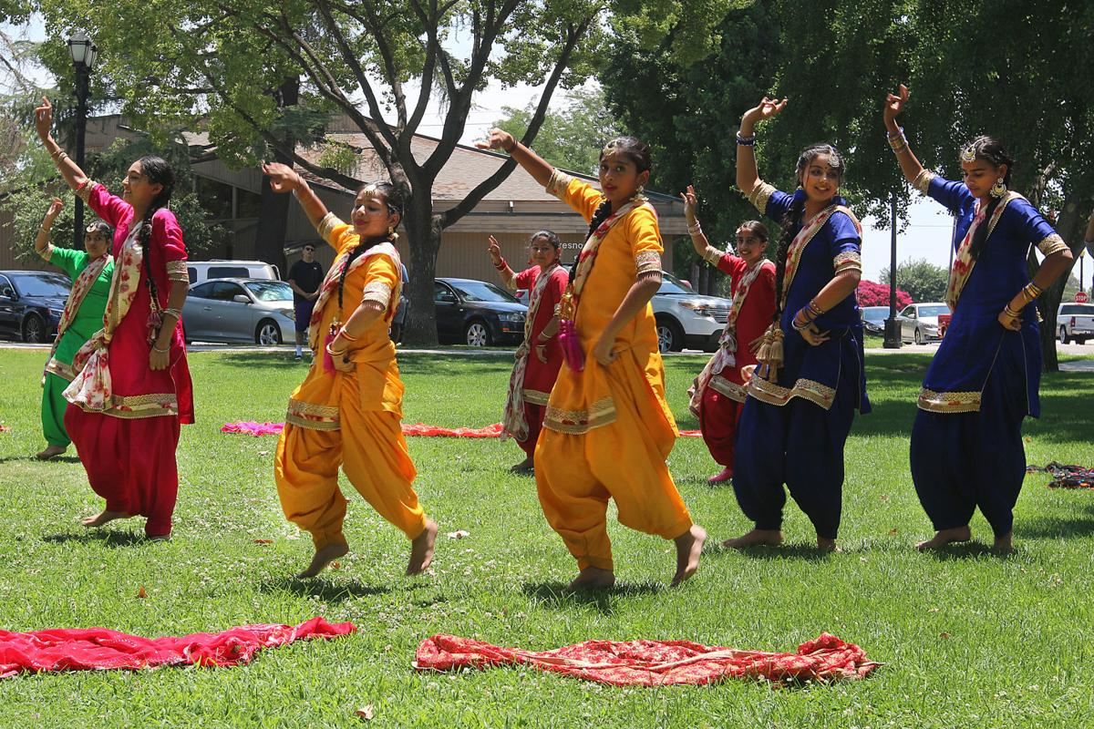 Sikhs: Bhangra Dancers