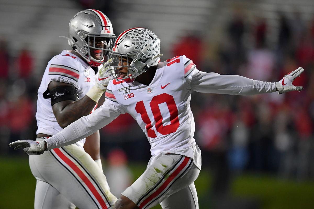 EVANSTON, ILLINOIS - OCTOBER 18: Amir Riep #10 of the Ohio State Buckeyes celebrates after his interception in the second half against the Northwestern Wildcats at Ryan Field on October 18, 2019 in Evanston, Illinois.