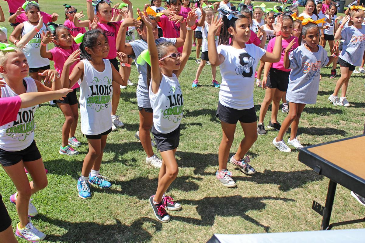 Cheer camp: Kingsburg cheerleaders learn new routines