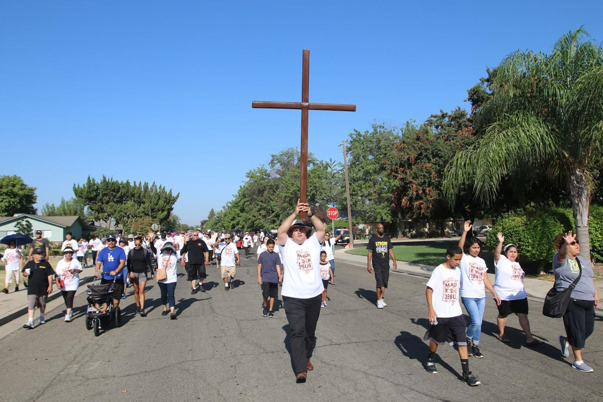March: Carrying the cross