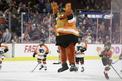 Philadelphia Flyers mascot Gritty celebrates his goal in between periods during the Arizona Coyotes vs. Philadelphia Flyers NHL game at the Wells Fargo Center in Philadelphia on Nov. 8, 2018.
