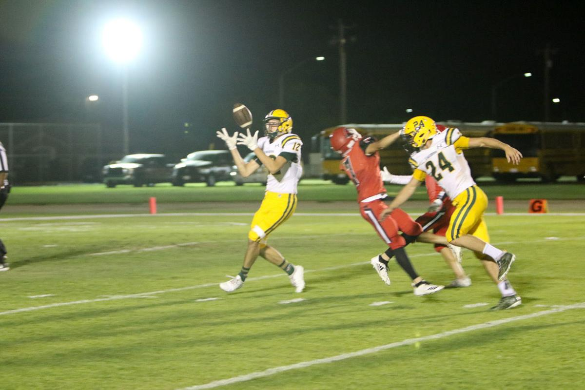 Kingsburg football: Kaden Tate catches tipped pass