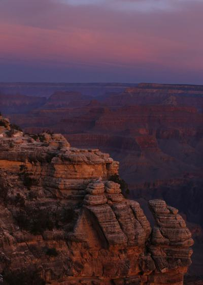 The colors of dawn begin to paint the age-old rock formations of the Grand Canyon along the South Rim near Mather Point on March 11, 2015. Many national parks are so far remaining open during the coronavirus pandemic.