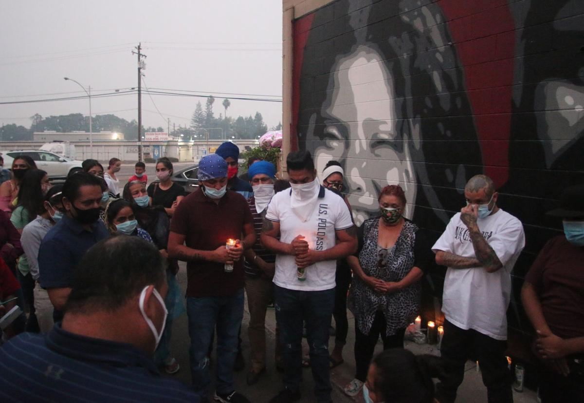 Community gathers for candlelight vigil