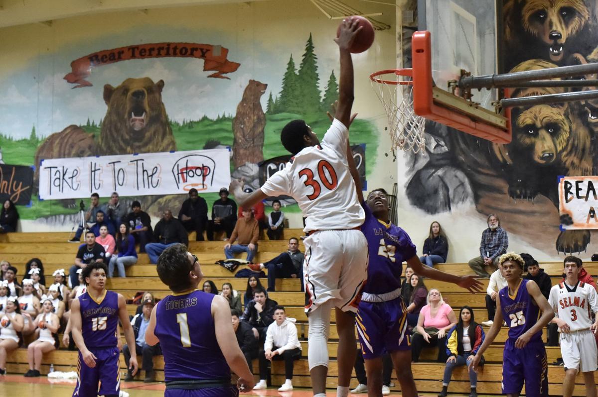 Selma basketball: Tiveon Stroud dunks vs Lemoore