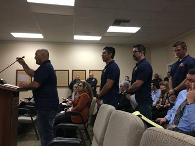 Firefighters at council meeting