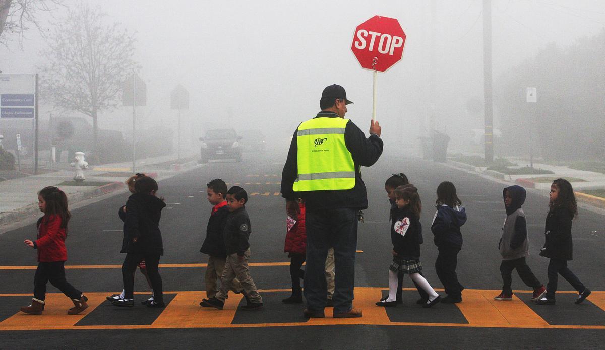 Crossing guard at St Rose McCarthy in fog
