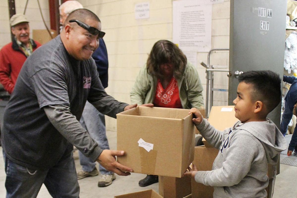 KCAPS food drive: Vera father and son