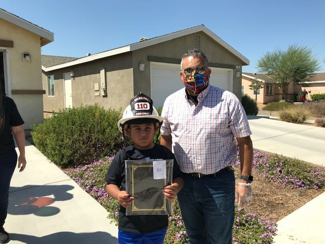 Drive-by parade held for young cancer patient