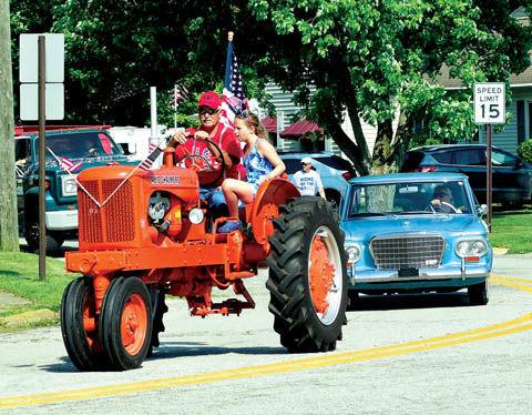 7 12 WEB 4th 2 tractor.jpg