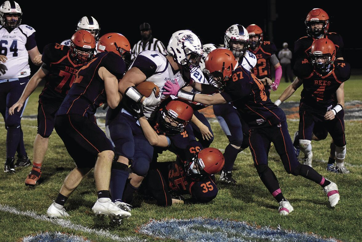 11 12 WEB Sports Bee Football 2 Heckathorn tackled.jpg