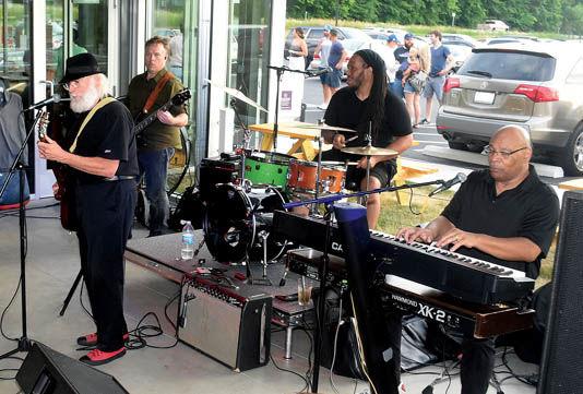6 26 WEB Music 1 Ghost Isle Duke band.jpg