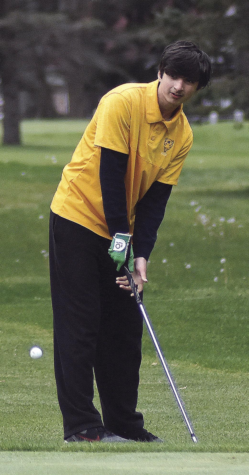 5 13 Sports Golf 2 NB Moser putts.jpg