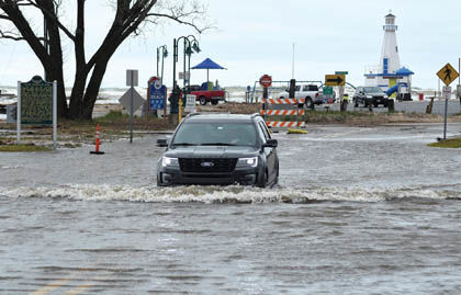 5 8 Flooded Shore 1 SUV pushes wave.jpg