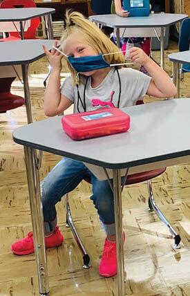 9 4 WEB Schools 1 RV girl in mask.jpg