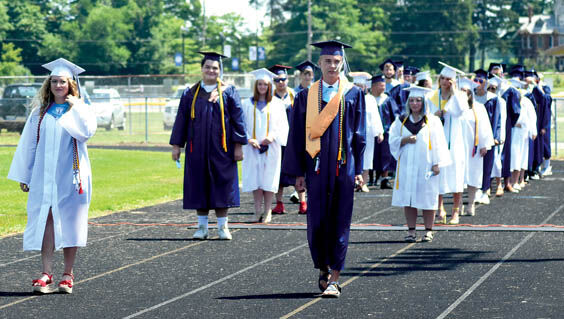 7 24 WEB RV Grad 1 walking in.jpg