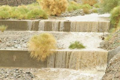 Stormwater flows through a wash