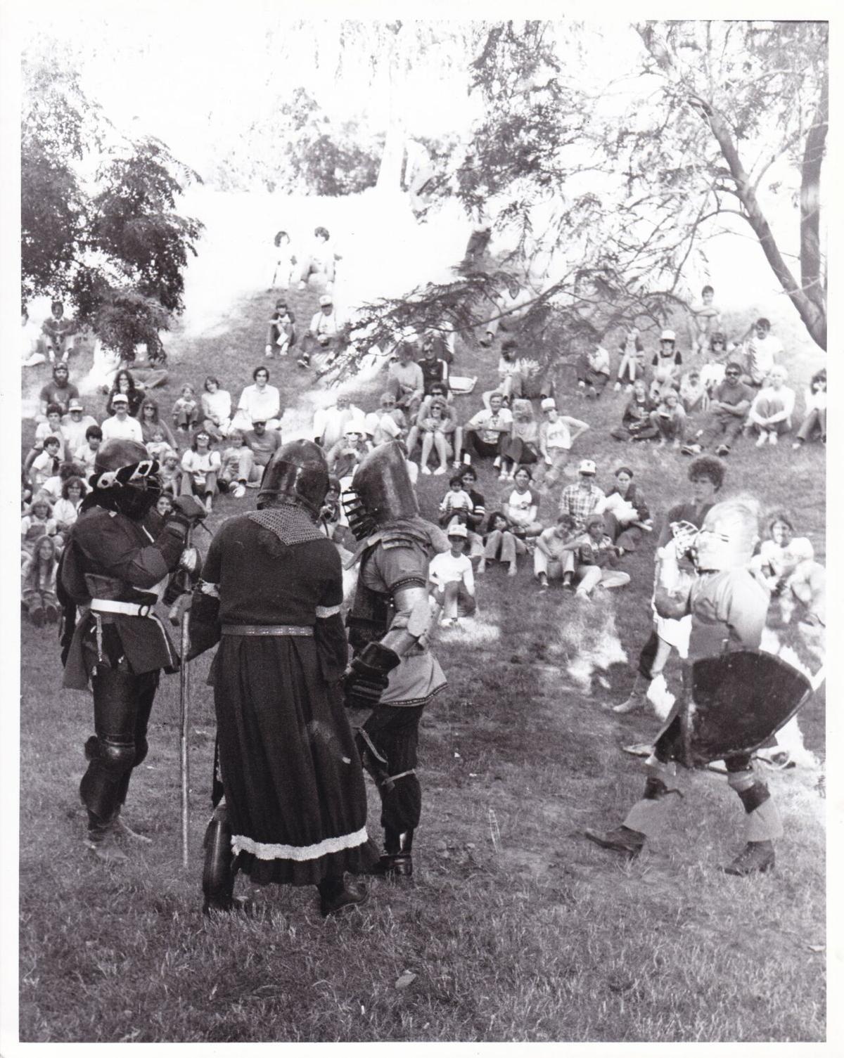 3 men in crowd wearing elizabethan costumes.jpg